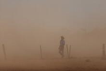 Farmer In Dust Storm