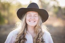 Teenage Girl Laughing With Eye...