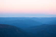 View Of Mountain Ranges At Sun...
