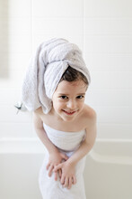 Young Girl Wrapped In Towels C...