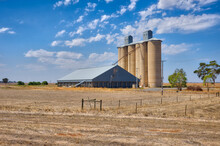 Wheat Silos And Storage Sheds In Dry Sunny Landscape
