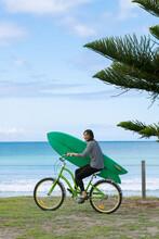 Aussie Surf Girl With Surfboard On Bike