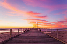 Looking Along A Jetty At Sunset