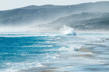 Seahaze And Waves Crashing Into Shore