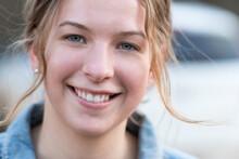 Smiling Teenage Girl With Flya...