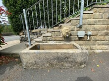 Old Stone Victorian Water Trough, Next To Some Steps, With A Gargoyle Water Spout In, Hebden Bridge, Halifax, UK
