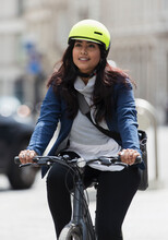 Woman With Helmet Riding Bicycle