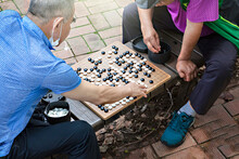 Old People Playing A Game Of Go