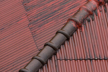 The Roof Darkly Covers The House. The Red Tile Is Natural Weathered. Roof Corner Is Traditional