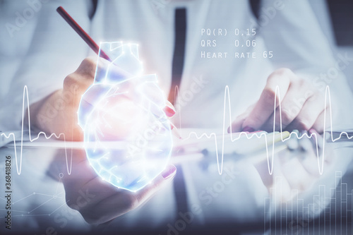 Fototapeta Heart hologram over woman's hands writing background. Concept of Medical education study. Double exposure obraz