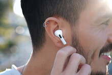 Bluetooth Headphones On The Ear Of A Young Male Person.
