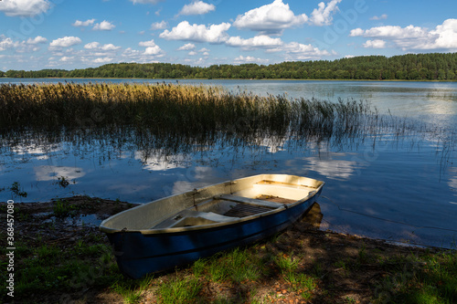 Fototapety, obrazy: Boats and boat moorings on the lake