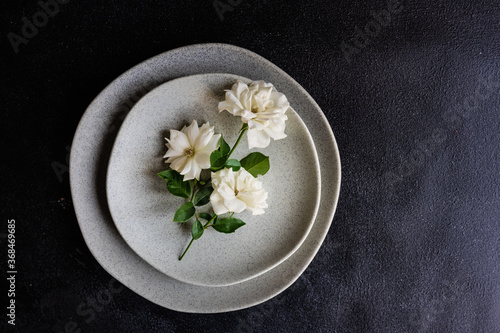 Canvas Minimalistic table setting with white rose