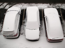 High Angle Shot Of Cars Covere...