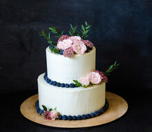 Two Tiered Wedding Cream Cheese Cake With Roses And Blueberries