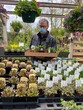 Man shopping in a garden center during the Covid-19 virus pandemic while wearing a surgical mask