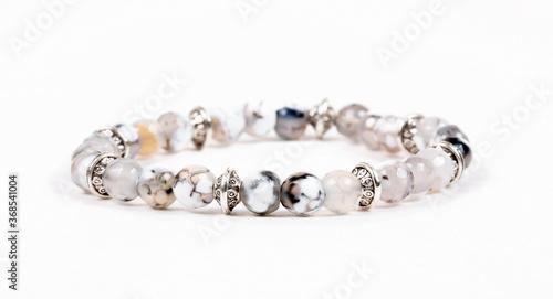 Fotografija Beaded bracelet on the white surface