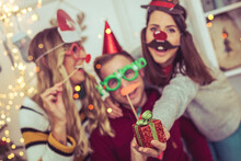 Young Friends Celebrate Christmas Party With Photo Booth
