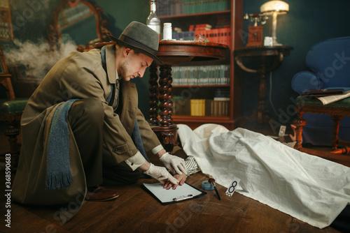 Obraz na plátně Detective takes fingerprints at the crime scene