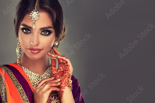 Portrait of a beautiful indian girl .India woman in traditional sari dress and jewelry.