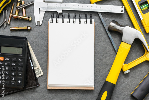 Obraz Construction cost or repair calculation mockup. Blank page notepad and work tools on the workbench. - fototapety do salonu