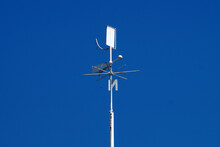 Weather Station Weather Vane Close-up On A Background Of Clear Blue Sky