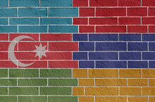 Flags Of Armenia And Azerbaijan On A Brick Wall. Image On The Theme Of International Conflict