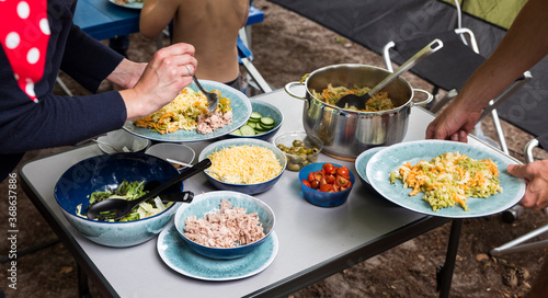 Fototapeta camping meal with lettuce and pasta obraz
