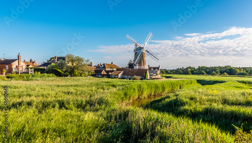 Fotografie, Obraz A view of the marshes and the river Glaven towards the village of Cley, Norfolk,