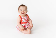 Cute Smiling Baby Wearing Strawberry Outfit On White Background