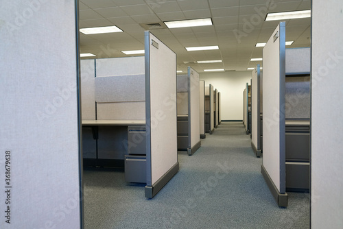 Obraz cubicles inside office building, place of work - fototapety do salonu