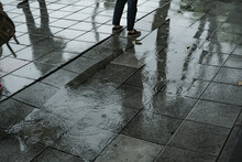 Rain On The Footpath With Puddle