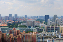 Architectural Panoramic Shot Of Toa Payoh Central Skyline On A Sunny Day. Greenery Is Interspersed Among The Dense High Rise, Typically Colourful, Public Housing Buildings (HDB Flats)