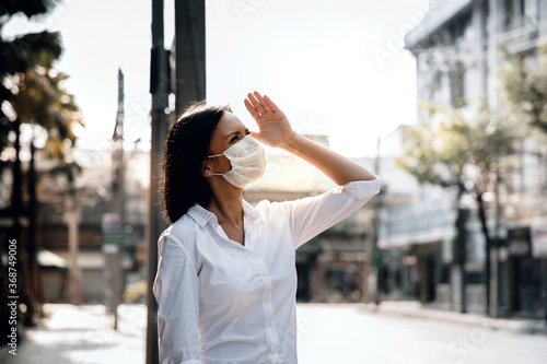 Fototapeta Weather, Pollution and Ecology Issue Concept. Young Woman Wearing Protection Mask against Roadside in the City obraz