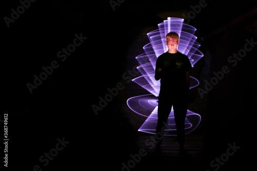 Fototapeta Silhouette of a man using a smartphone