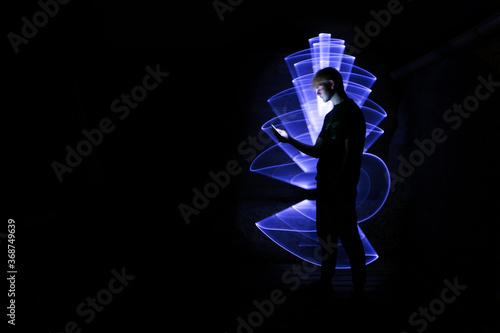 Obraz na plátně Silhouette of a man using a smartphone