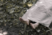 The Human Corpse Is Covered With A Sheet. The Victim Of The Crime Lies In The Forest.