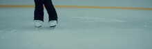 CU On Skates, Professional Female Ice Figure Skater Performing Spin On Ice. Shot On RED Cinema Camera With 2x Anamorphic Lens