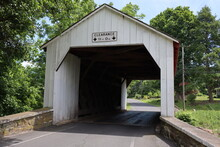 The Old Covered Bridge In The Park.
