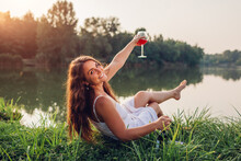 Young Woman Enjoying Glass Of ...