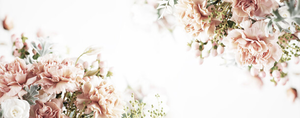 Autumn pastel composition made of beautiful flowers and berries on light backdrop. Floristic decoration. Natural floral background.