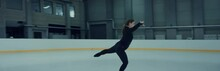 Professional Female Ice Figure Skater Practicing On Indoor Skating Rink Shot On RED Cinema Camera With 2x Anamorphic Lens, 75 FPS Slow Motion