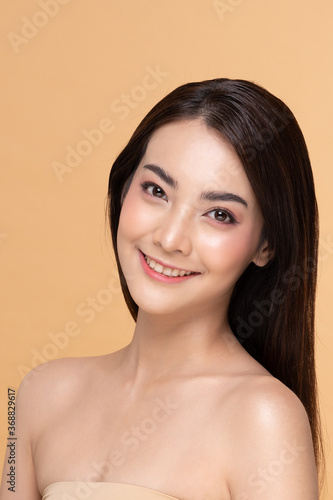Fototapety, obrazy: Beautiful Asian woman looking at camera smile with clean and fresh skin Happiness and cheerful with positive emotional,isolated on Beige background,Beauty Cosmetics and spa Facial treatment Concept