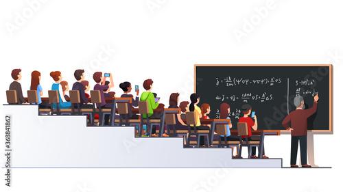 Fotografiet Professor writing formula on big class blackboard