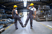 Workers Wearing Uniforms And H...