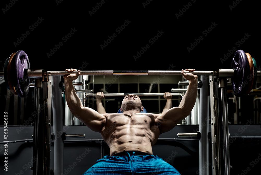 Fototapeta Man bodybuilder perform exercise
