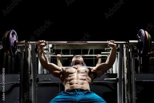 Man bodybuilder perform exercise Fototapeta