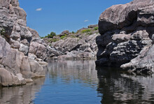 Explore. Geology. View Of The River Flowing Along The Rocky Cliffs Called The Elephants In Mina Clavero, Cordoba, Argentina.