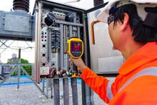 Electrical Engineers Used A Thermometer To Check For Faults In Equipment Sets, Also Known As Preventive Maintenance To Reduce The Damage Of Equipment.