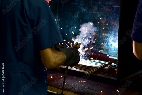 Thai Technologist Steel welding metal In the workshop class with flames and smoke floating out Canvas-taulu